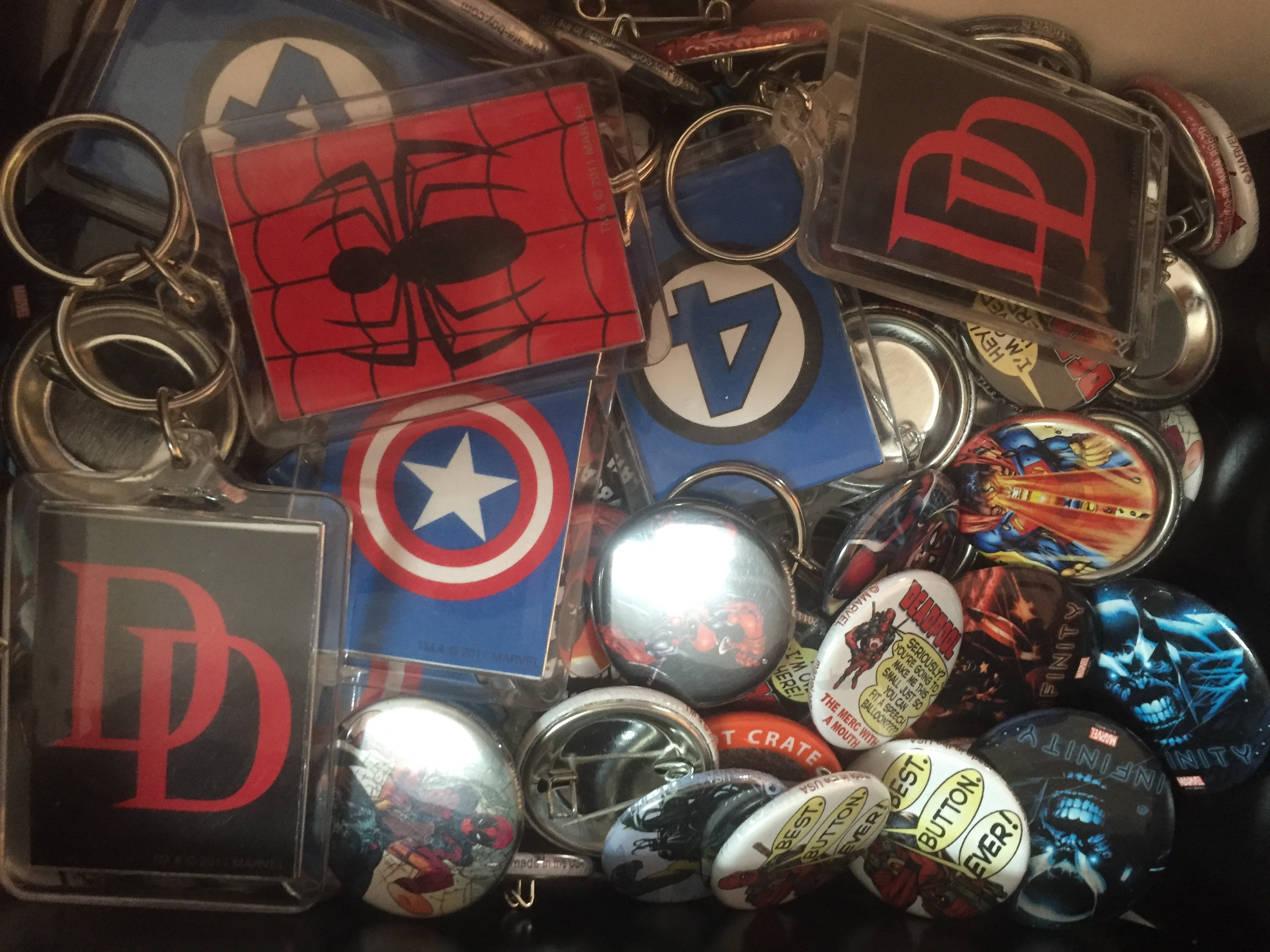 "<span  class=""uc_style_uc_tiles_grid_image_elementor_uc_items_attribute_title"" style=""color:#ffffff;"">Comic Book Buttons and Keychains</span>"