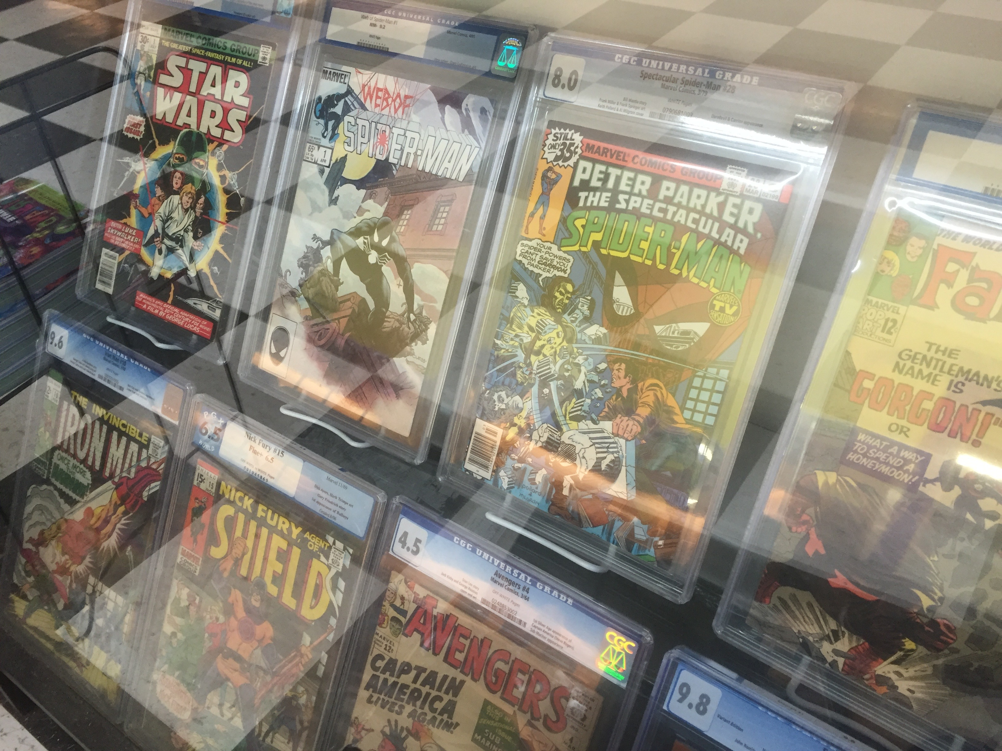 "<span  class=""uc_style_uc_tiles_grid_image_elementor_uc_items_attribute_title"" style=""color:#ffffff;"">Graded Comics at Mammoth Comics</span>"