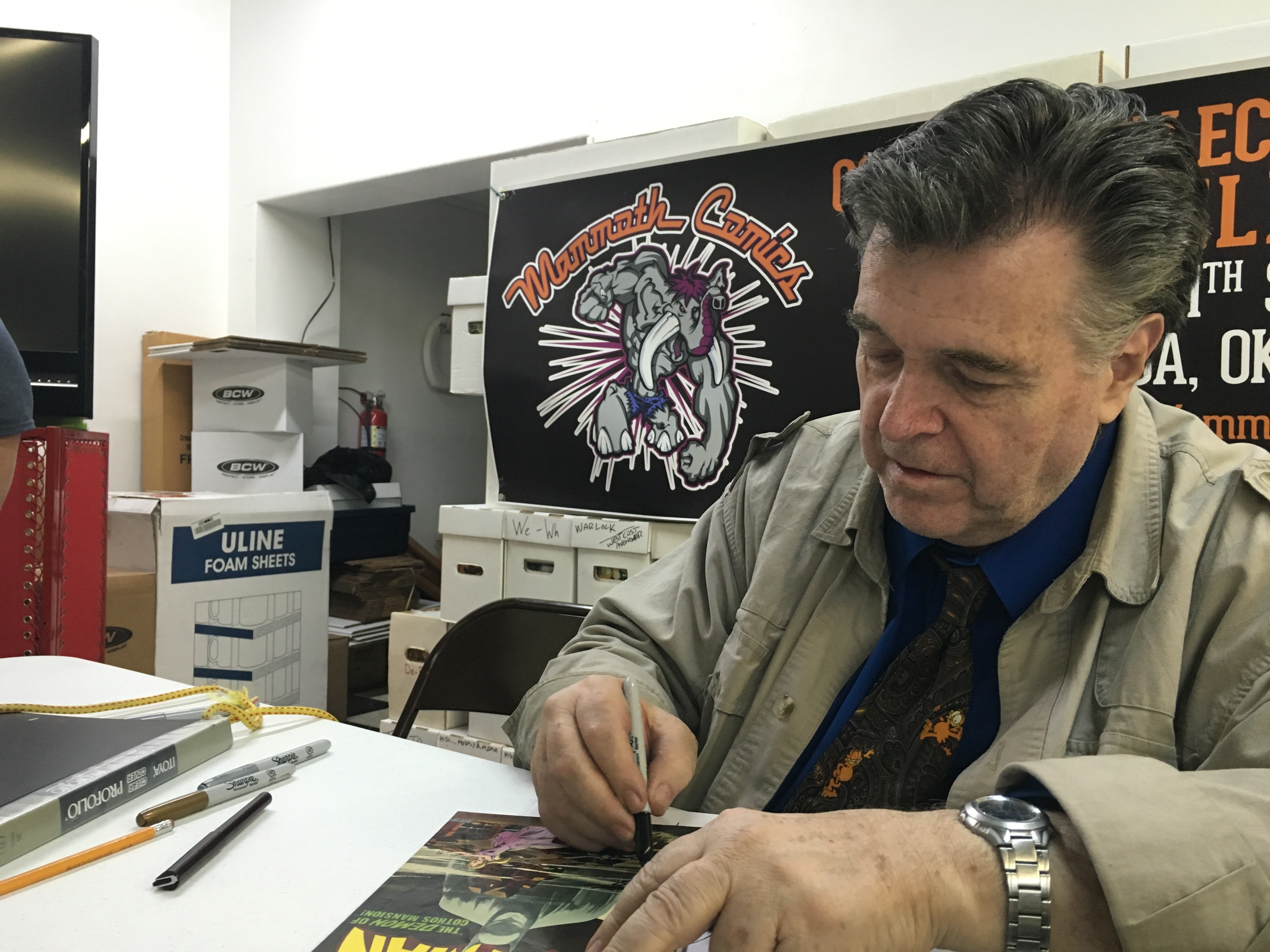 "<span  class=""uc_style_uc_tiles_grid_image_elementor_uc_items_attribute_title"" style=""color:#ffffff;"">Neal Adams at Mammoth Comics</span>"