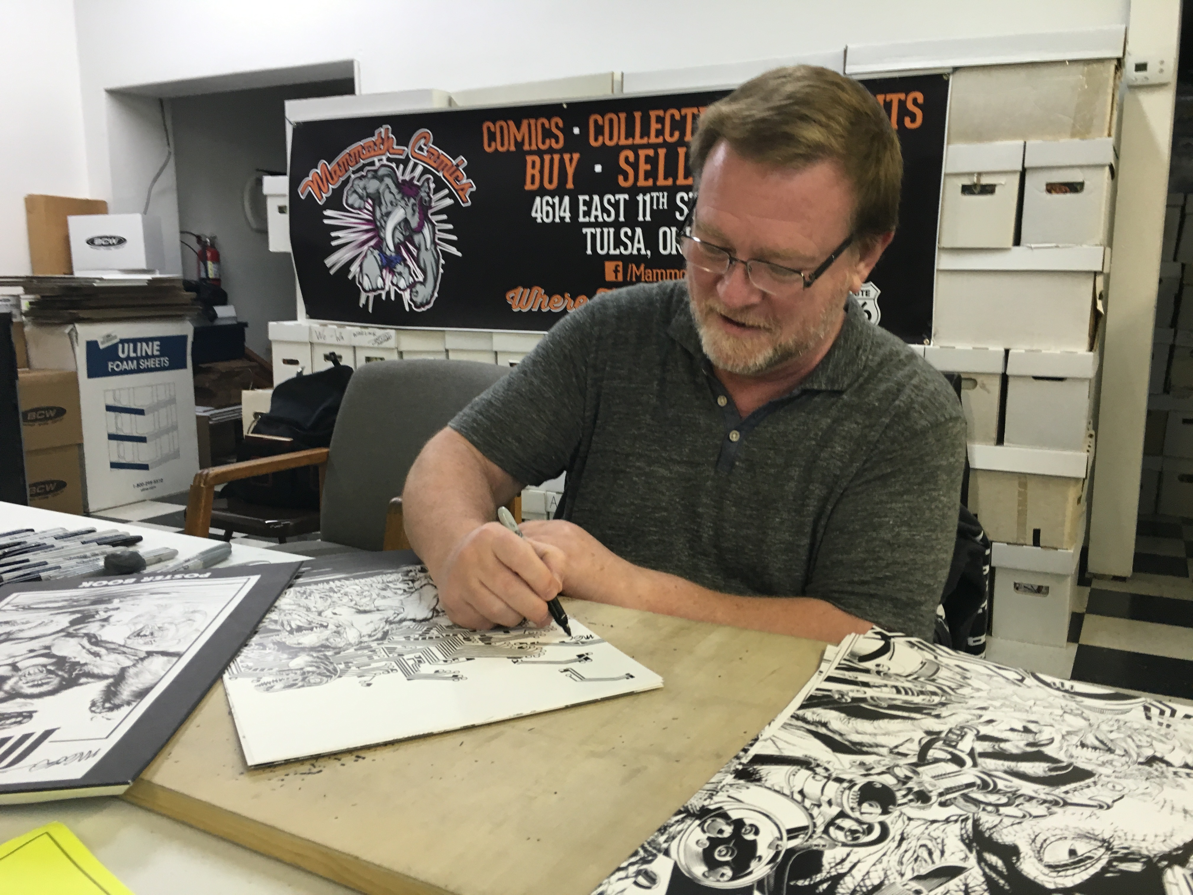 "<span  class=""uc_style_uc_tiles_grid_image_elementor_uc_items_attribute_title"" style=""color:#ffffff;"">Michael Golden at Mammoth Comics</span>"